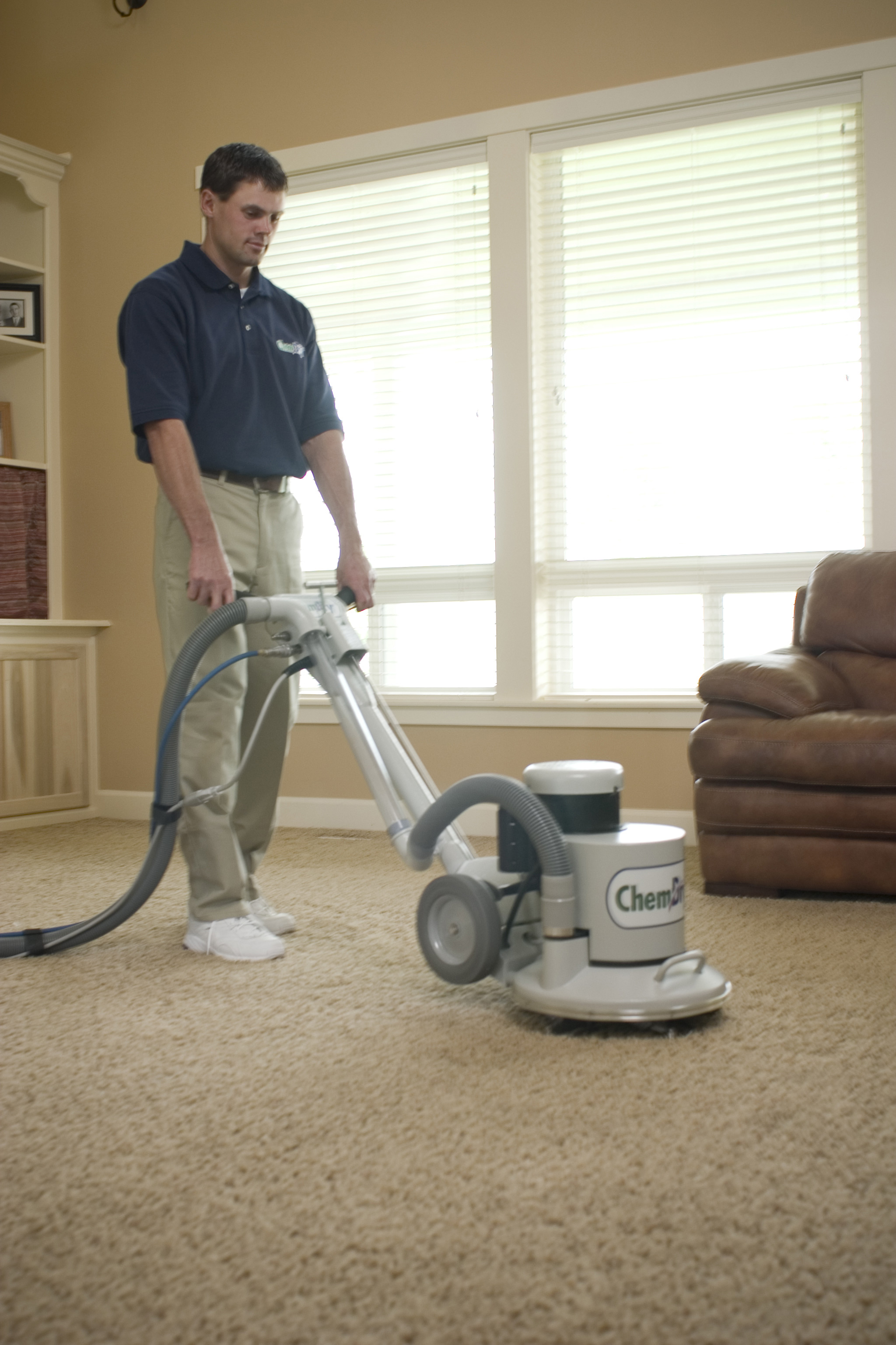 Executive Chem-Dry Technician Performing Professional Carpet Cleaning