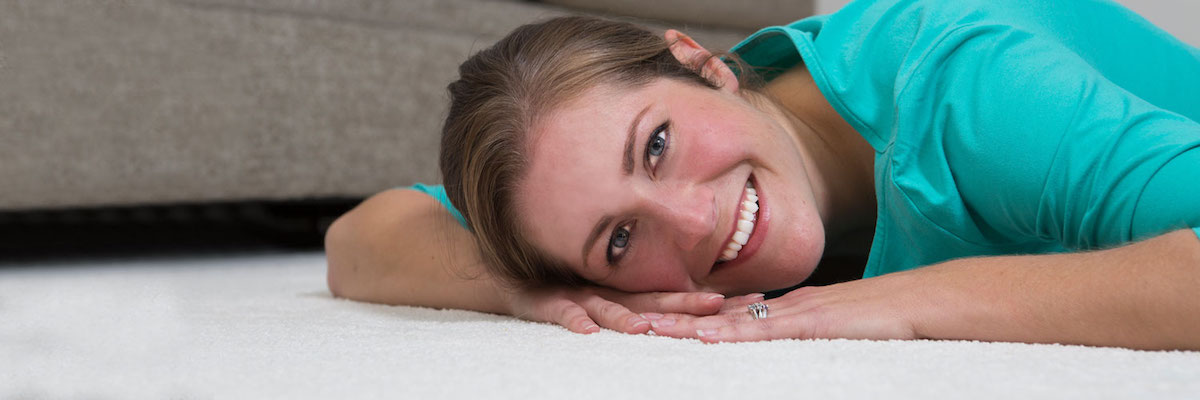 Woman Laying on White, Stain-Free Carpet in Shawnee